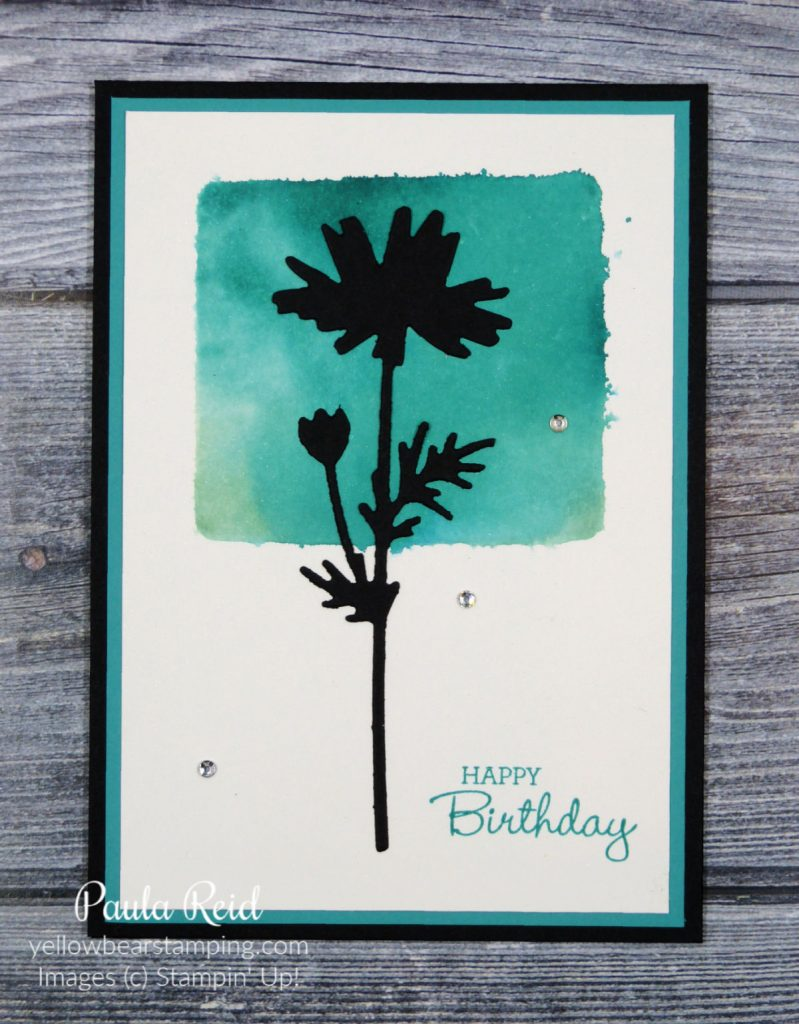 Clear block, ink and a water spritzer to create a cool background for stamped or die cut images